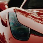 macro photography of red sports car