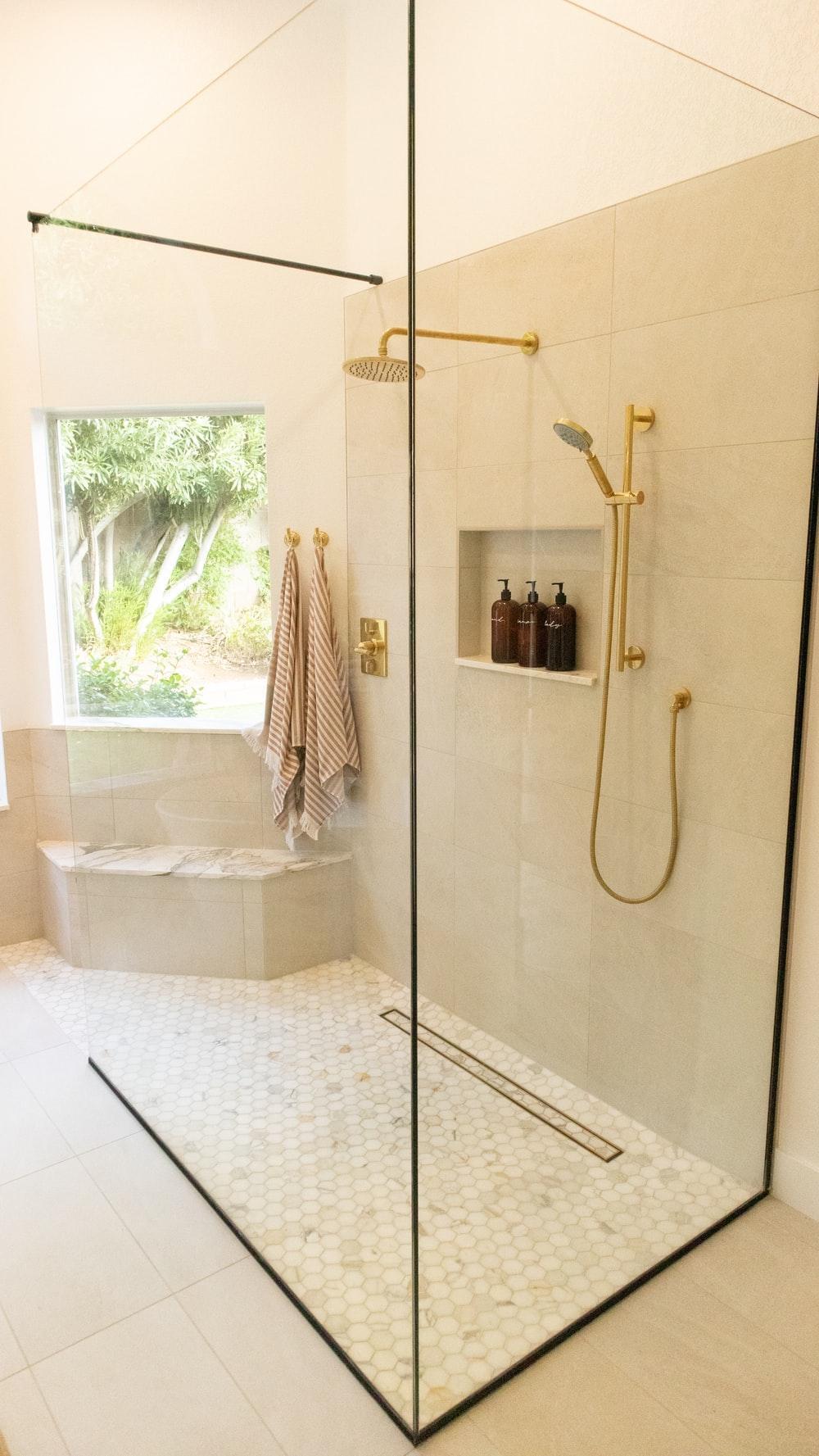 white bathtub with shower curtain